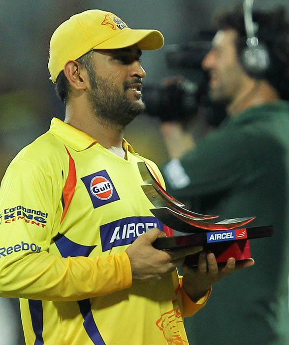 Chennai Super Kings skipper MS Dhoni poses with his Man of the Match trophy after the win over Delhi Daredevils in the IPL 4 match in Chennai. (PTI Photo)