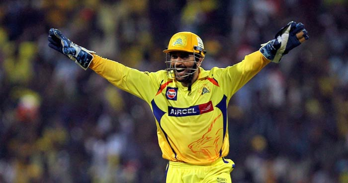 Mahendra Singh Dhoni celebrates the dismissal of Colin Ingram during an IPL match in Chennai. (AP Photo)