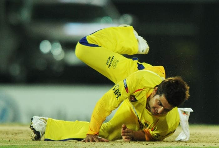Suresh Raina dives to try to stop a shot from a Delhi batsman during the IPL Twenty20 match between Chennai Super Kings and Delhi Daredevils at the M.A.Chidambaram Stadium in Chennai. (AFP Photo)