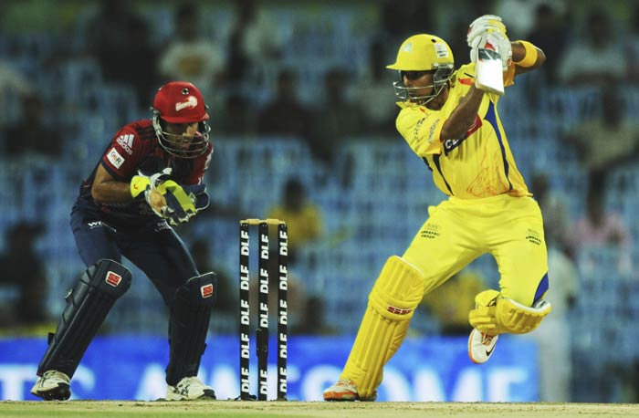 S Badrinath is watched by Naman Ojha as he plays a shot during the IPL Twenty20 match between Chennai Super Kings and Delhi Daredevils at the M.A. Chidambaram Stadium in Chennai. (AFP Photo)