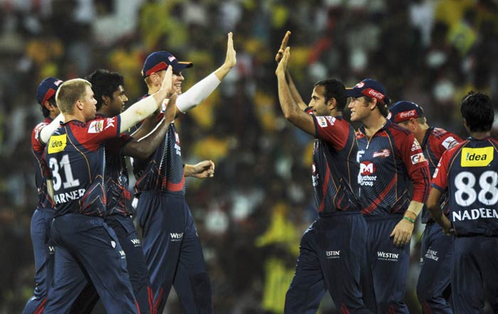 Delhi Daredevils players congratulate Irfan Pathan for taking the catch of Suresh Raina during the IPL Twenty20 match between Chennai Super Kings and Delhi Daredevils at the M.A. Chidambaram Stadium in Chennai. (AFP Photo)