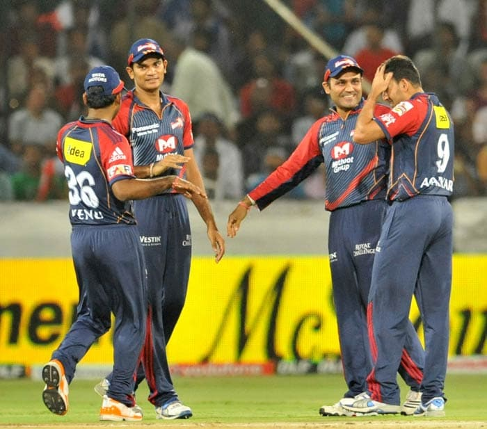 Ajit Agarkar and Virender Sehwag celebrate the wicket of Shikhar Dhawan during the IPL Twenty20 match between the Delhi Daredevils and the Deccan Chargers at the Rajiv Gandhi International Stadium in Hyderabad. (AFP Photo)