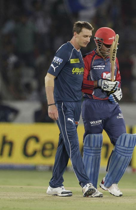 Virender Sehwag, dismissed by Dale Steyn, walks back to the pavilion during the IPL T20 match between the Delhi Daredevils and the Deccan Chargers in Hyderabad. (AP Photo)