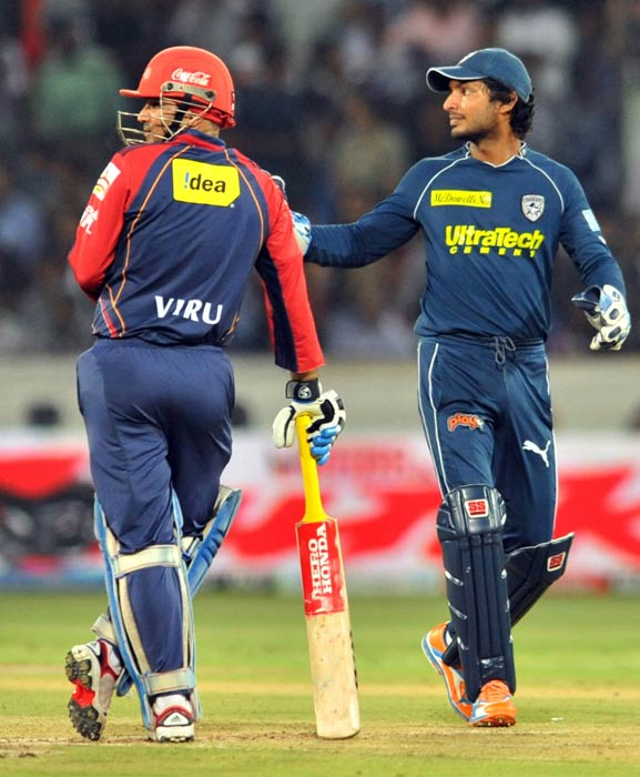 Virender Sehwag and Kumar Sangakkara look on during the IPL Twenty20 match between the Delhi Daredevils and the Deccan Chargers at the Rajiv Gandhi International Stadium in Hyderabad. (AFP Photo)
