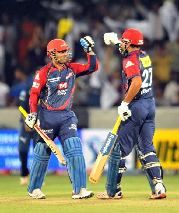 Virender Sehwag is congratulated by teammate Irfan Pathan for scoring his century (100 runs) during the IPL Twenty20 match between the Delhi Daredevils and the Deccan Chargers at the Rajiv Gandhi International Stadium in Hyderabad. (AFP Photo)
