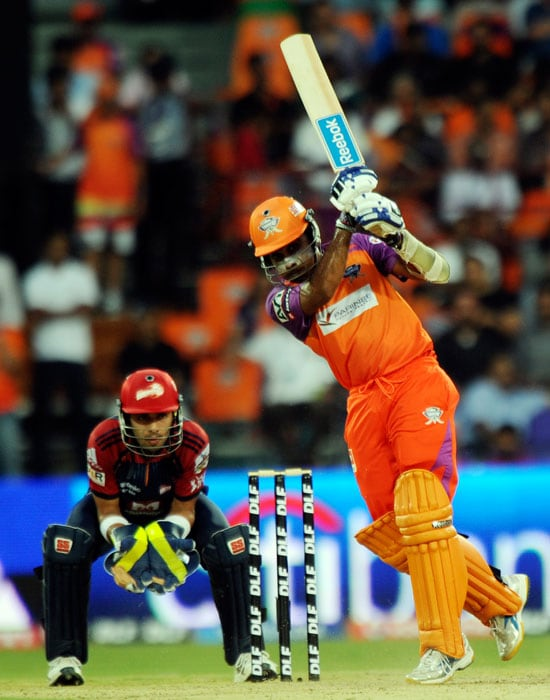 Mahela Jayawardena, watched by Naman Ojha, plays a shot during the IPL Twenty20 match between Kochi Tuskers Kerala and Delhi Daredevils at the Jawaharlal Nehru International Stadium in Kochi. (AFP Photo)