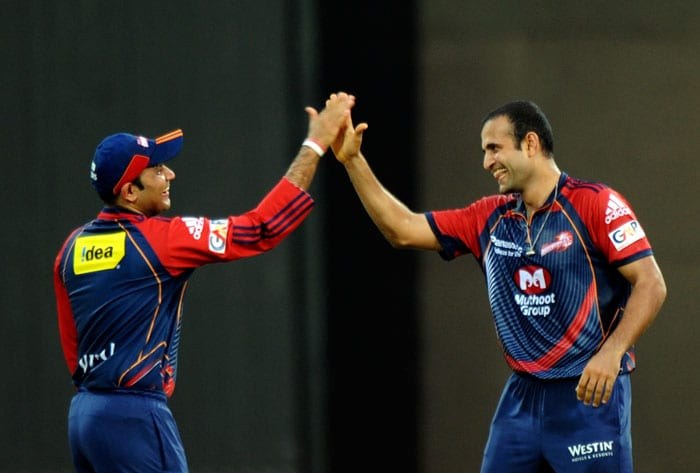 Irfan Pathan celebrates the wicket of Parthiv Patel with captain Virender Sehwag during the IPL Twenty20 match between Kochi Tuskers Kerala and Delhi Daredevils at the Jawaharlal Nehru International Stadium in Kochi. (AFP Photo)