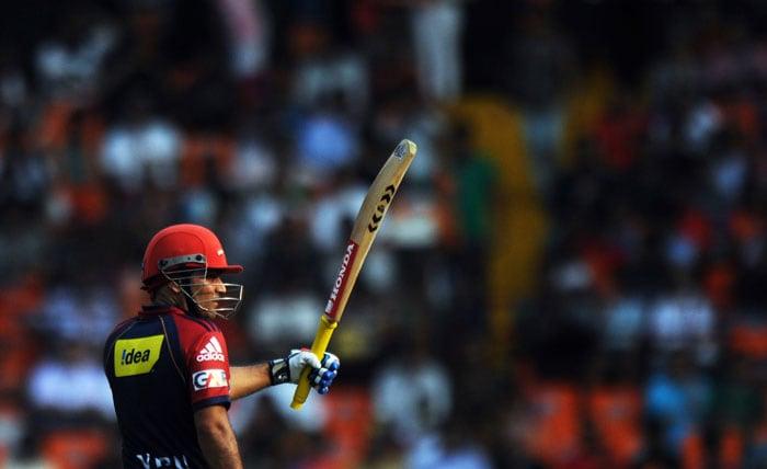 Virender Sehwag celebrates after scoring a half-century (50runs) during the IPL Twenty20 match between Kochi Tuskers Kerala and Delhi Daredevils at the Jawaharlal Nehru International Stadium in Kochi. (AFP Photo)