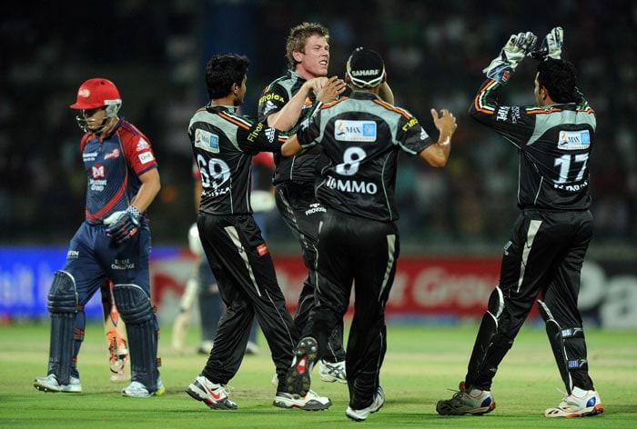 James Faulkner celebrates the wicket of David Warner with teammates during the IPL Twenty20 match between Delhi Daredevils and Pune Warriors at the Feroz Shah Kotla stadium in New Delhi. (AFP Photo)