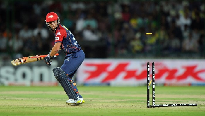 David Warner watches his bails go into the air after being clean bowled by James Faulkner during the IPL Twenty20 match between Delhi Daredevils and Pune Warriors at the Feroz Shah Kotla stadium in New Delhi. (AFP Photo)