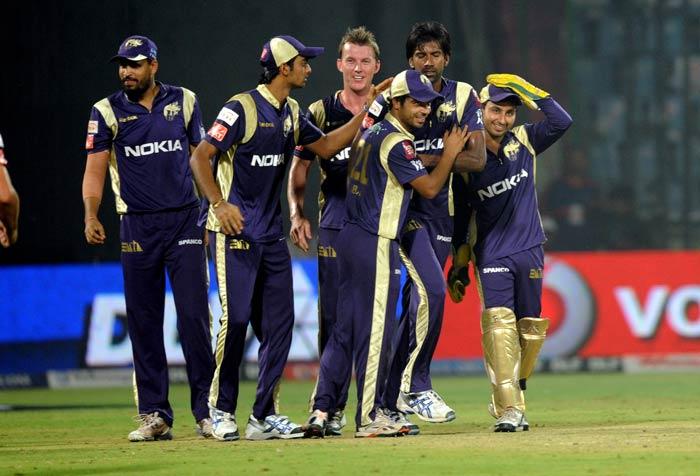 Kolkata Knight Riders players celebrate their victory in their IPL Twenty20 match against the Delhi Daredevils at the Feroz Shah Kotla stadium in New Delhi. Kolkata Knight Riders won the match by 17 runs. (AFP Photo)
