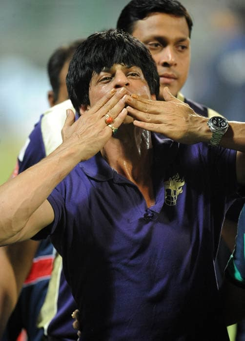 Bollywood actor and owner of the Kolkata Knight Riders Shah Rukh Khan celebrates his team's victory in their IPL Twenty20 match against the Delhi Daredevils at the Feroz Shah Kotla stadium in New Delhi. Kolkata Knight Riders won the match by 17 runs. (AFP Photo)