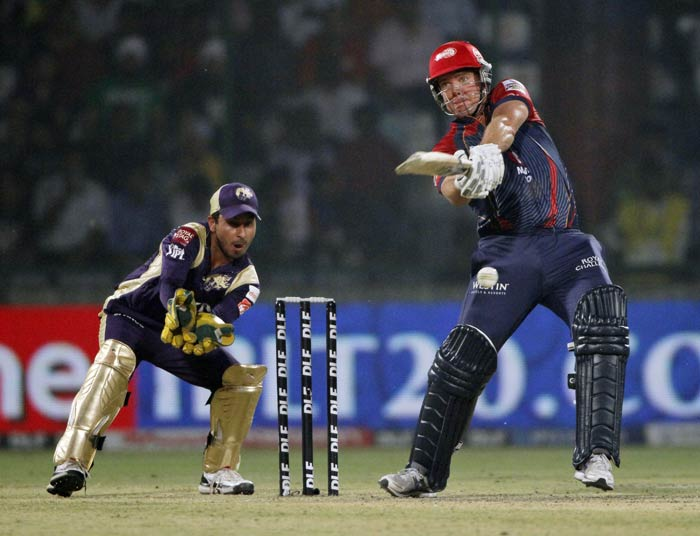 James Hopes attempts a shot as wicketkeeper Shreevats Goswami watches during an IPL match between Delhi Daredevils and Kolkata Knight Riders in New Delhi. (AP Photo)