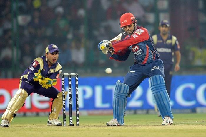 Shreevats Goswami watches Virender Sehwag play a shot during the IPL Twenty20 match between Kolkata Knight Riders and Delhi Daredevils at the Feroz Shah Kotla stadium in New Delhi. (AFP Photo)