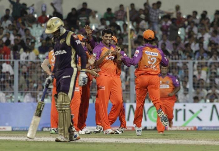 RP Singh is congratulated by teammates after he dismissed Gautam Gambhir during the IPL match between Kolkata Knight Riders and Kochi Tuskers Kerala in Kolkata. (AP Photo)
