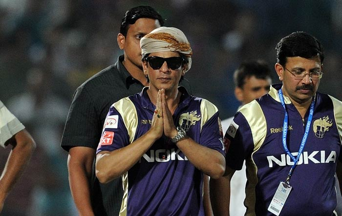 Bollywood actor and co-owner of the Kolkata Knight Riders, Shah Rukh Khan gestures to the spectators after his team's win against the Rajasthan Royals at the Sawai Man Singh Stadium in Jaipur. (AFP Photo)