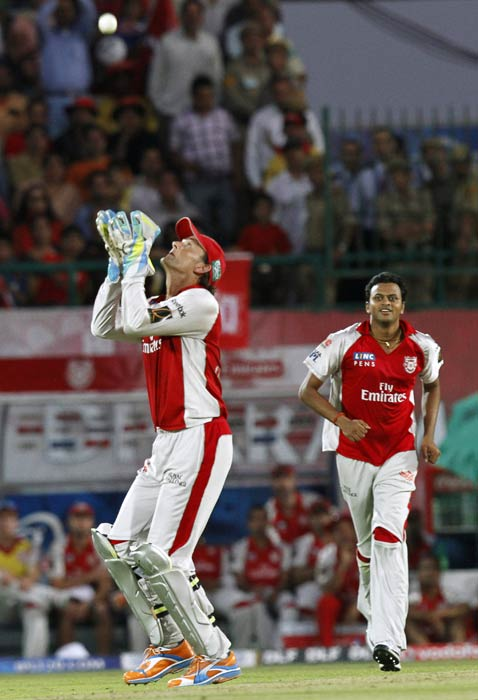Adam Gilchrist tries to catch a ball during the IPL Twenty20 match between Delhi Daredevils and Kings XI Punjab at Himachal Pradesh Cricket Association stadium in Dharamsala. (AP Photo)