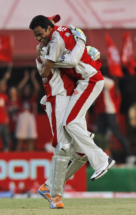 Adam Gilchrist and Shalabh Srivastava celebrate the dismissal of David Warner during the IPL Twenty20 match between Delhi Daredevils and Kings XI Punjab at Himachal Pradesh Cricket Association stadium in Dharamsala. (AP Photo)