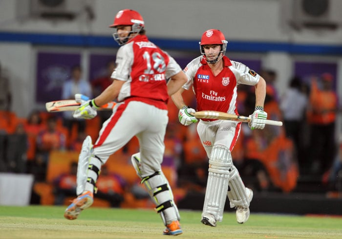 Adam Gilchrist run along with his teammate Shaun Marsh between the wickets during the IPL Twenty20 match between Kochi Tuskers Kerala and Kings XI Punjab at the Holkar Stadium in Indore. (AFP Photo)