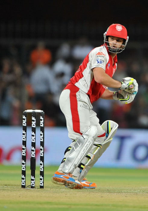 Adam Gilchrist watches a ball during the IPL Twenty20 match between Kochi Tuskers Kerala and Kings XI Punjab at the Holkar Stadium in Indore. (AFP Photo)