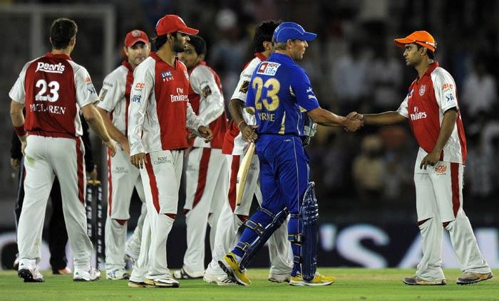 Rajasthan Royals' captain Shane Warne congratulates Kings XI Punjab's Paul Valthaty on winning their IPL Twenty20 match at the Punjab Cricket Association stadium in Mohali. Kings XI Punjab beat Rajasthan Royals by 48 runs. (AFP Photo)