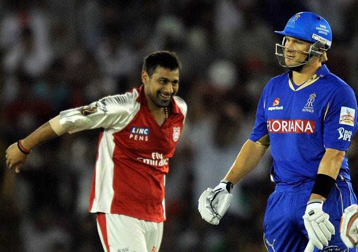 Praveen Kumar celebrates after taking the wicket of Shane Watson during the IPL Twenty20 match between the Rajasthan Royals and the Kings XI Punjab at the Punjab Cricket Association stadium in Mohali. (AFP Photo)