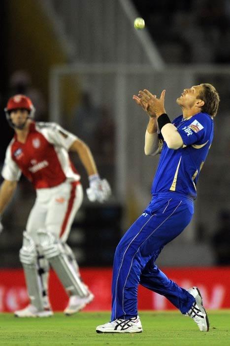 Shane Watson takes a catch to dismiss Shaun Marsh during the IPL Twenty20 match between Rajasthan Royals and Kings XI Punjab at the Punjab Cricket Association stadium in Mohali. (AFP Photo)