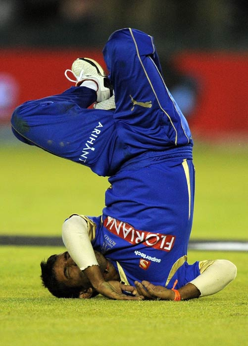 Swapnil Asnodkar falls after dropping a catch of Paul Valthaty during the IPL Twenty20 match between Rajasthan Royals and Kings XI Punjab at the Punjab Cricket Association stadium in Mohali. (AFP Photo)