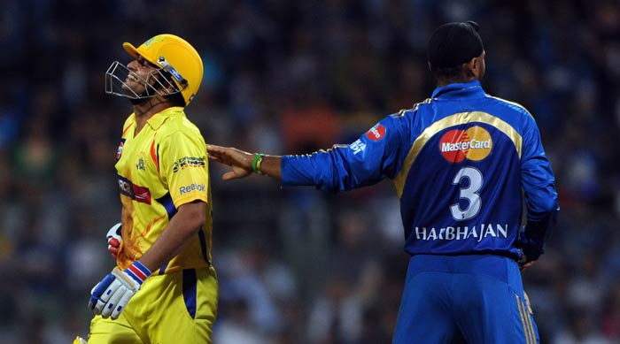 Suresh Raina gets a comforting pat by Harbhajan singh after getting hurt during the IPL match between Chennai Super Kings and Mumbai Indians at the Wankhede Stadium in Mumbai. (AFP Photo)