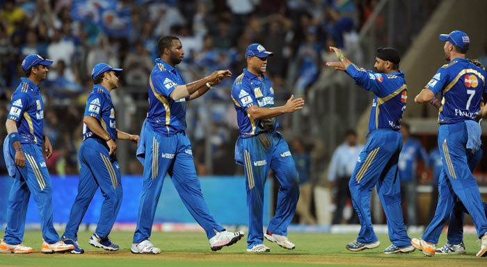 Mumbai Indians cricketers celebrate the dismissal of Michael Hussey during the IPL Twenty20 match between Chennai Super Kings and Mumbai Indians at the Wankhede Stadium in Mumbai. (AFP Photo)