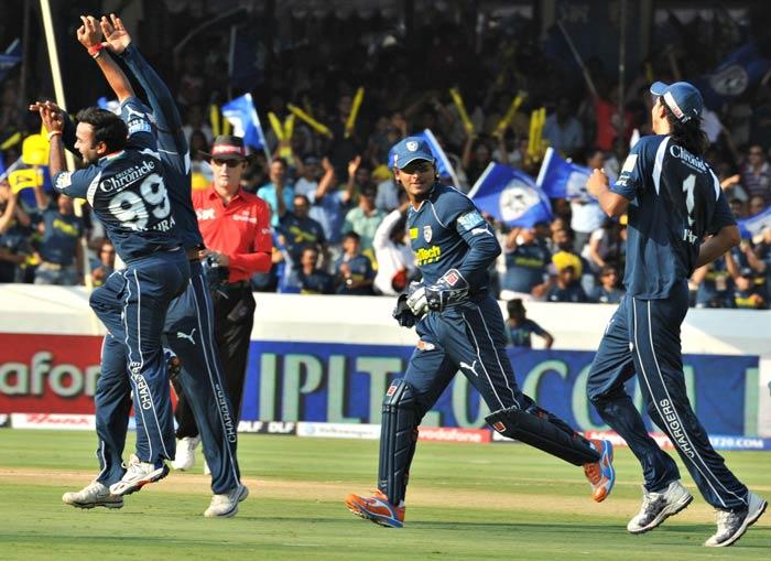 Amit Mishra celebrates the wicket of Sachin Tendulkar during the IPL Twenty20 match between Deccan Chargers and Mumbai Indians at the Rajiv Gandhi International Stadium in Hyderabad. (AFP Photo)