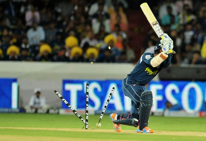 Kumara Sangakkara is bowled out by Lasith Malinga during the IPL Twenty20 match between Deccan Chargers and Mumbai Indians at the Rajiv Gandhi International Stadium in Hyderabad. (AFP Photo)