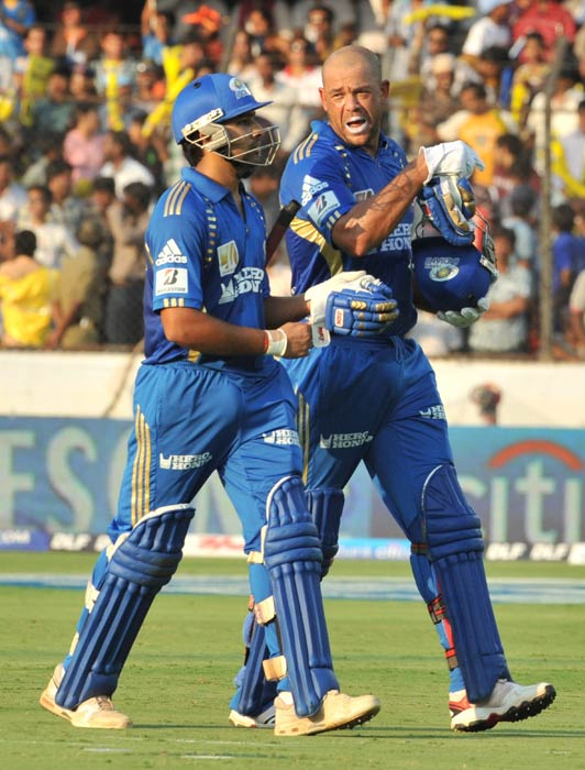 Rohit Sharma and teammate Andrew Symonds walk back after their innings during the IPL Twenty20 match between Deccan Chargers and Mumbai Indians at the Rajiv Gandhi International Stadium in Hyderabad. (AFP Photo)