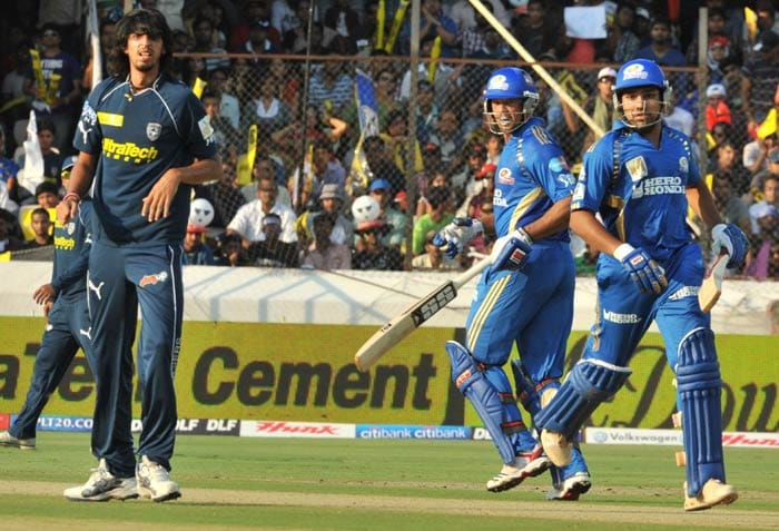 Rohit Sharma and Andrew Symonds run between the wickets as Ishant Sharma looks on during the IPL Twenty20 match between Deccan Chargers and Mumbai Indians at the Rajiv Gandhi International Stadium in Hyderabad. (AFP Photo)
