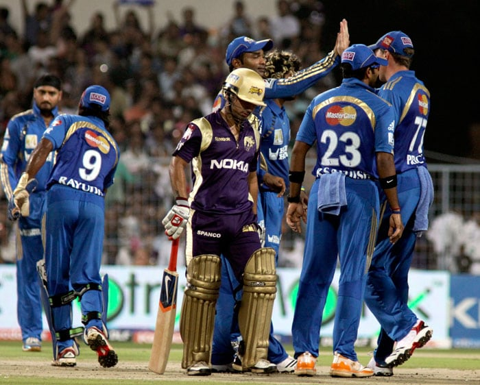 Mumbai Indians cricketers celebrate the wickets of Shreevats Goswami during the IPL Twenty20 match between Kolkata Knight Riders and Mumbai Indians at the Eden Gardens in Kolkata. (AFP Photo)