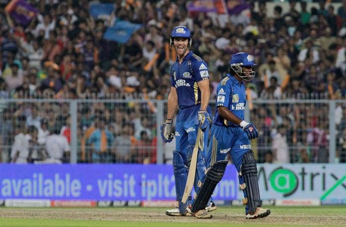 Ambati Rayudu and James Franklin share a light moment during the IPL match between Mumbai Indians and Kolkata Knight Riders in Kolkata. (AP Photo)