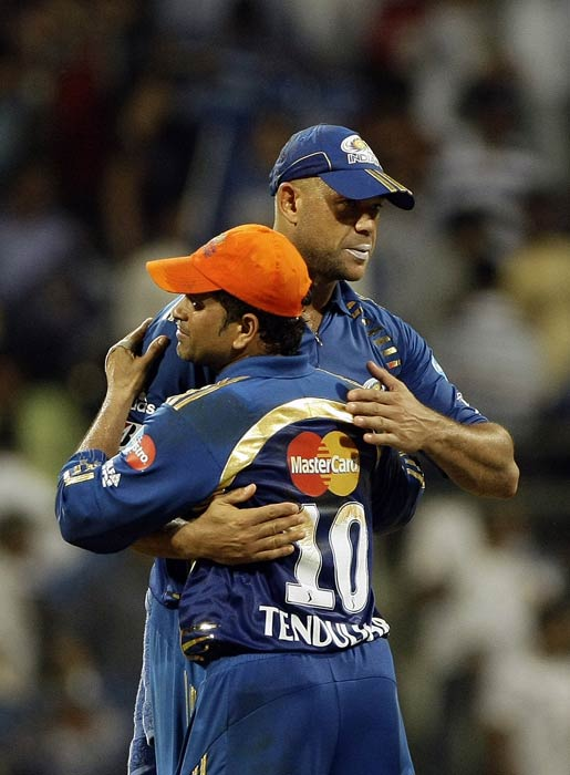 Mumbai Indians skipper Sachin Tendulkar and Andrew Symonds celebrate after they won the Indian Premier League match against Kings XI Punjab at the Wankhede Stadium in Mumbai. (AP Photo)