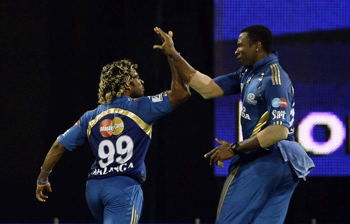 Lasith Malinga and Kieron Pollard celebrate the wicket of Yuvraj Singh during the IPL match between Mumbai Indians and Pune Warriors in Mumbai. (AP Photo)