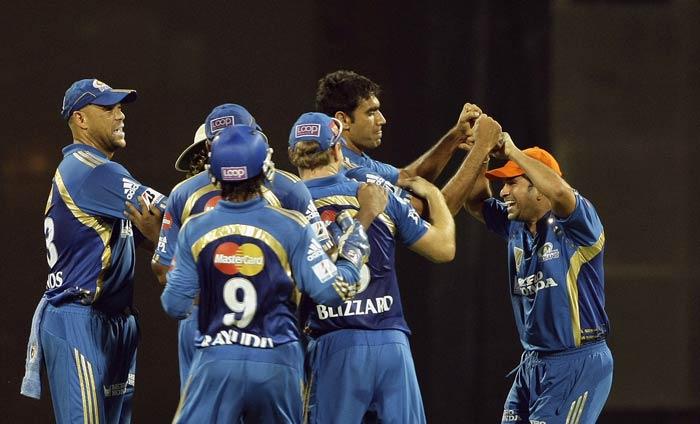Andrew Symonds, Munaf Patel and Sachin Tendulkar celebrate Graeme Smith's wicket during the IPL match between Mumbai Indians and Pune Warriors in Mumbai. (AP Photo)