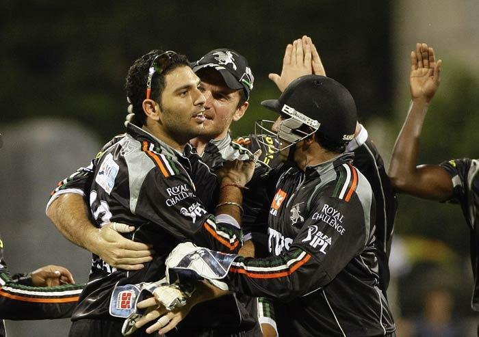Yuvraj Singh celebrates with teammates the wicket of Sachin Tendulkar during the IPL match between Mumbai Indians and Pune Warriors in Mumbai. (AP Photo)