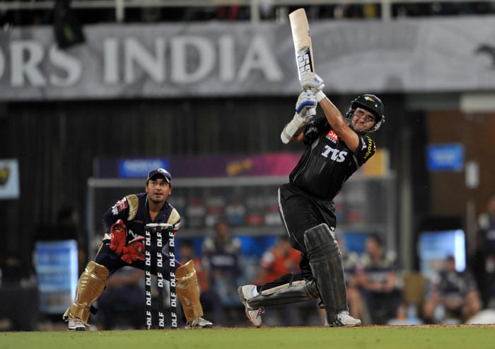 Sourav Ganguly plays a shot as Shreevats Goswami looks on during the IPL Twenty20 match between Pune Warriors India and Kolkata Knight Riders at the DY Patil Stadium on the outskirts of Mumbai. (AFP Photo)
