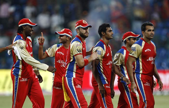 Royal Challengers Bangalore's captain Daniel Vettori leaves the field with teammates after their win in an Indian Premier League match against Pune Warriors in Bangalore. (AP Photo)