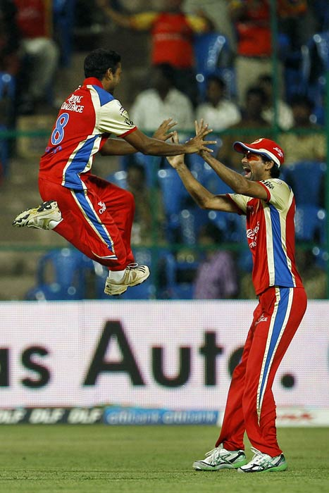 Mohammad Kaif and Syed Mohammad celebrate the dismissal of Jesse Ryder during an Indian Premier League match in Bangalore. (AP Photo)