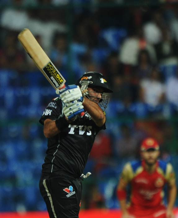 Yuvraj Singh plays a shot during the IPL Twenty20 match between Pune Warriors and Royal Challengers Bangalore at the M. Chinnaswamy Stadium in Bangalore. (AFP Photo)