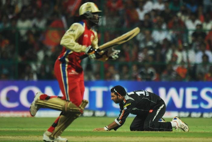 Yuvraj Singh reacts after missing a ball as Chris Gayle takes a run during the IPL Twenty20 match between Pune Warriors and Royal Challengers Bangalore at the M.Chinnaswamy Stadium in Bangalore. (AFP Photo)