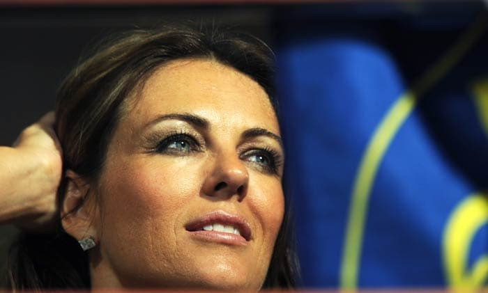 Shane Warne's girlfriend Liz Hurley looks on as the IPL Twenty20 match between Rajasthan Royals and Royal Challengers Bangalore is called off due to bad weather at the M.Chinnaswamy Stadium in Bangalore. (AFP Photo)