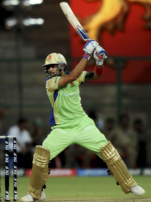 Virat Kohli plays a shot during the IPL Twenty20 match between Royal Challengers Bangalore and Kochi Tuskers Kerala at the M.Chinnaswamy Stadium in Bangalore. (AFP Photo)