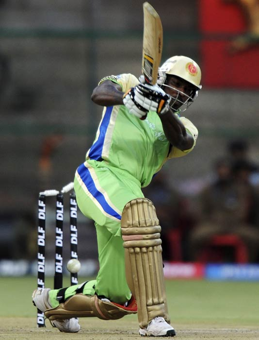 Chris Gayle misses a shot as he is clean bowled during the IPL Twenty20 match between Royal Challengers Bangalore and Kochi Tuskers Kerala at the M.Chinnaswamy Stadium in Bangalore. (AFP Photo)