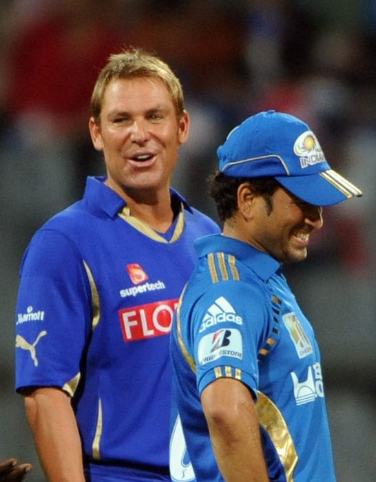 Sachin Tendulkar and Shane Warne share a light moment during the toss before the IPL Twenty20 match between Rajasthan Royals and Mumbai Indians at the Wankhede Stadium in Mumbai. (AFP Photo)