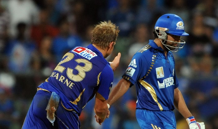 Shane Warne pats Rohit Sharma after getting dismissed during the IPL Twenty20 match between Rajasthan Royals and Mumbai Indians at the Wankhede Stadium in Mumbai. (AFP Photo)